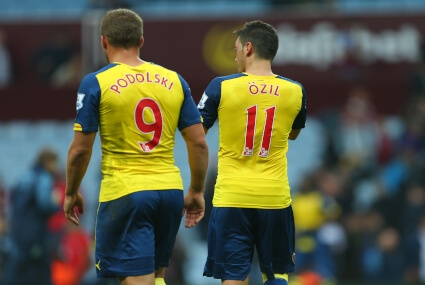 Podolski i Oezil w barwach Arsenalu